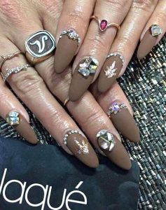 Vanessa Hudgens' brown matte jeweled manicure
