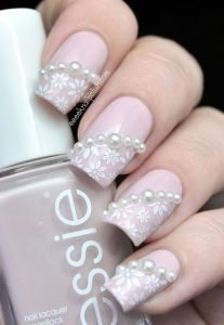 Light pink pearl essie manicure