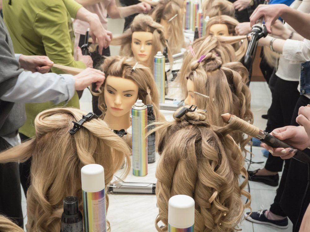 Mannequin heads for cosmetology school.